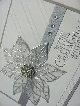 Lynn's beautiful card features Joyful Christmas images embossed in silver & Stylish Stripes embossing folder.