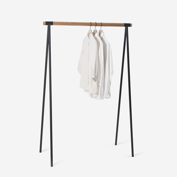 "The Alta Clothes Rack's slim profile and minimal details brings function and a touch of order to the corner of your bedroom. Made of heavy-gauge powder-coated steel legs and a 1.5"" diameter solid oak rail."