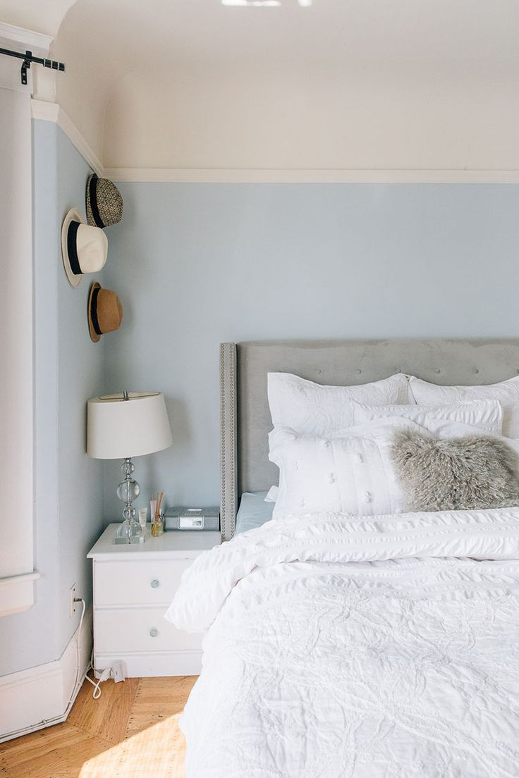 Julia Goodwin's San Francisco Home Tour #theeverygirl  *Paint Color Benjamin Moore Polar Ice **I like the idea of the grey tufted headboard with the paint color as well