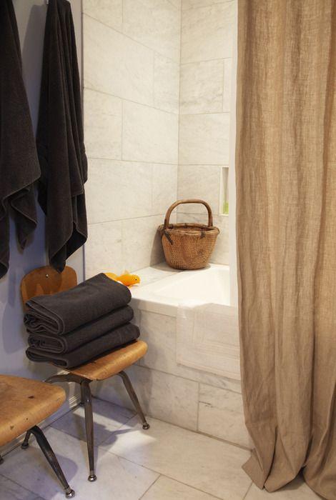 linen shower curtain, vintage chairs, dark towels