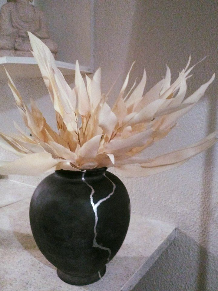Japanese Kintsugi style vase . For pricing and information email info@artandspaces.co.za. Custom pieces made to order.