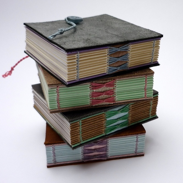 """Mini """"Shoe Leather"""" hand bound recycled notebooks by Kate Bowles"""
