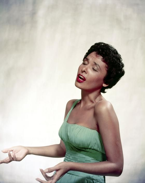 "Lena Horne, photographed as she sang by Philippe Halsmann in 1954. Ms. Horne was never a big fan of her own singing voice. In 1943, she told Newsweek magazine that she was still ""learning to sing,"" and she would later tell many interviewers how much..."
