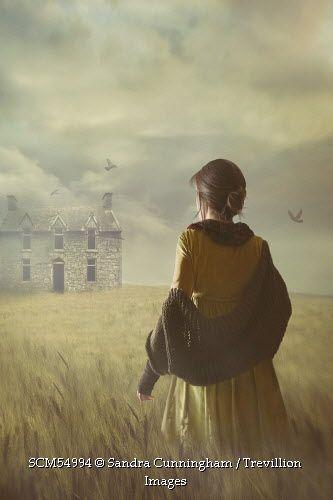 Trevillion Images - woman-walking-in-wheat-field