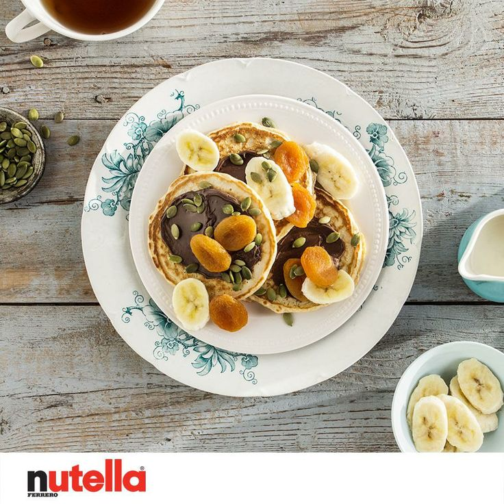 Nutella pancakes with Banana, Apricot and pumpkin seeds on top. Yum!