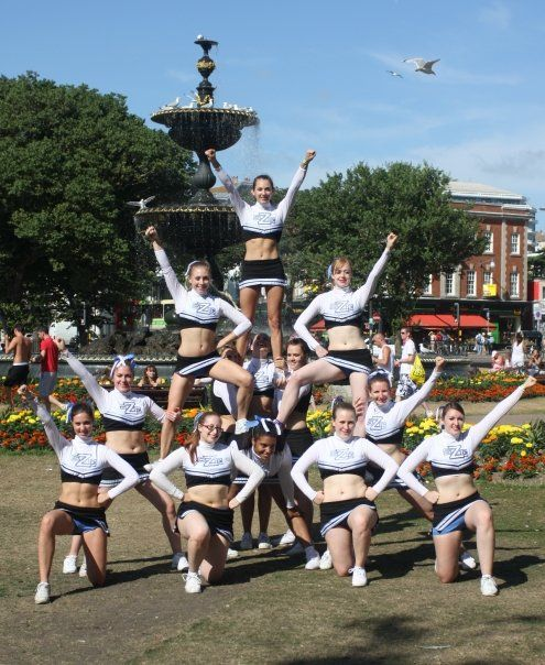 PICTURE: Visual effect created by positioning cheerleaders in a pattern which…