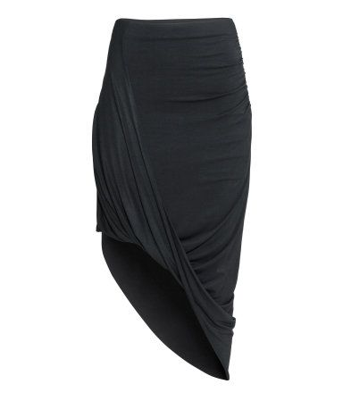 Skirt in jersey with a twisted, draped front section, concealed elastication at the waist, elastication in one side for an extra draped effect, and an asymmetric hem with raw edges. AU$ 39.95   H&M AU