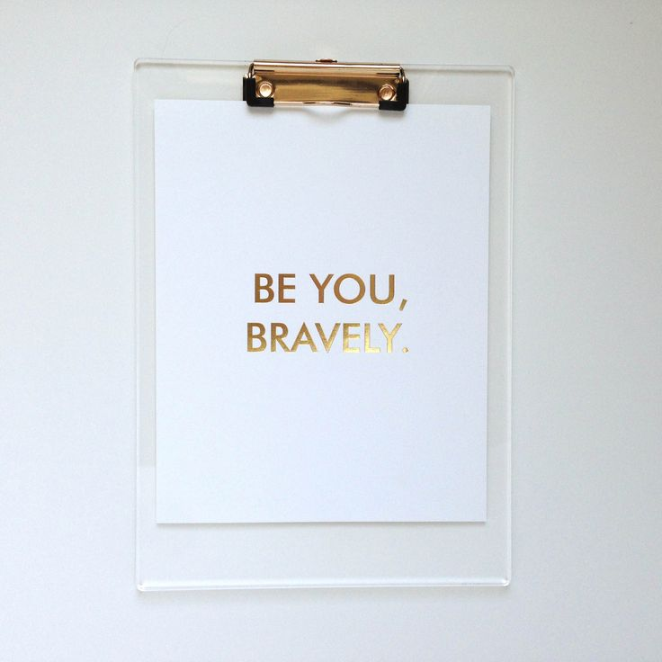 """""""Be you, bravely."""" Let this bold print remind you to take on each day with confidence! Bold and encouraging, this print measures 8x10"""" and would made the perfect addition for the modern home or office.Printed with vibrant gold foil on thick white card stock.Orders ship within 1-3 business days.© b is for bonnie design"""