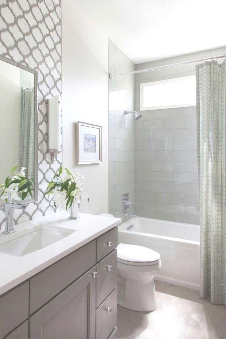 A master bathroom with a whirlpool tub, a rainfall showerhead ...
