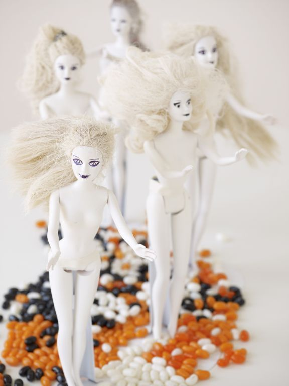 """barbies spray-painted white make downright frightening decorations. (called """"dolls of the living dead"""")"""