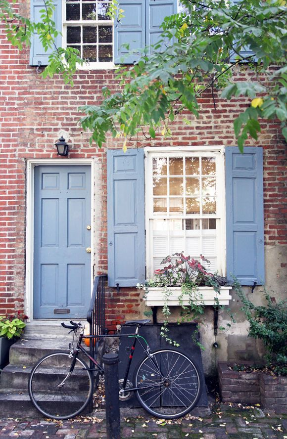About A Girl: Color & Print Graphic Artist, exterior, old bike, shutters, blue door, windows, home