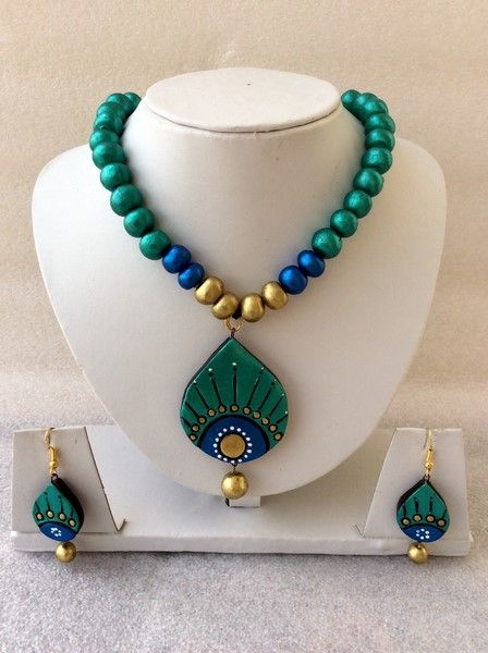 Peacock feather designer wear #terracotta #necklaceset shop with 33% discount at #craftshopsindia