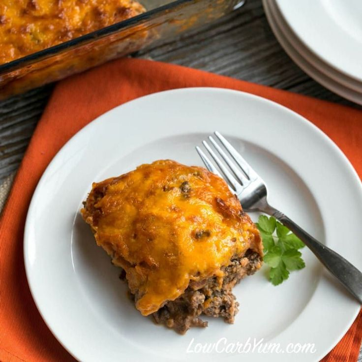 A low carb ground beef eggplant casserole that bakes in a casserole crock pot. It has a hamburger crust topped with layers of eggplant, tomato, and cheese.