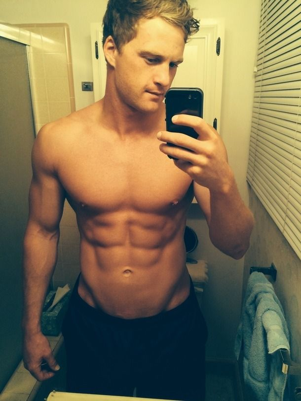 Hot guy taking picture in mirror