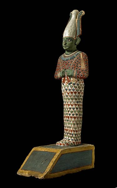 Painted wooden statuette of the god Osiris, ruler of the netherworld and judge of the dead.The figure is hollow and it contained the rolled Book of the Dead papyrus of a high-ranking woman named Anhai,c. 1150B.C. 20th dynasty