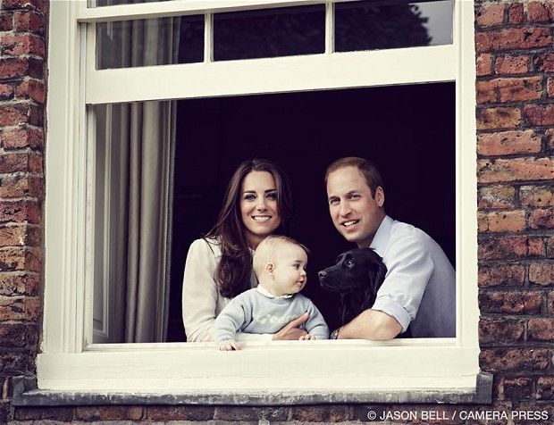 The Duke and Duchess of Cambridge with their son Prince George photographed at Kensington Palace. His sweater says George. Dying.