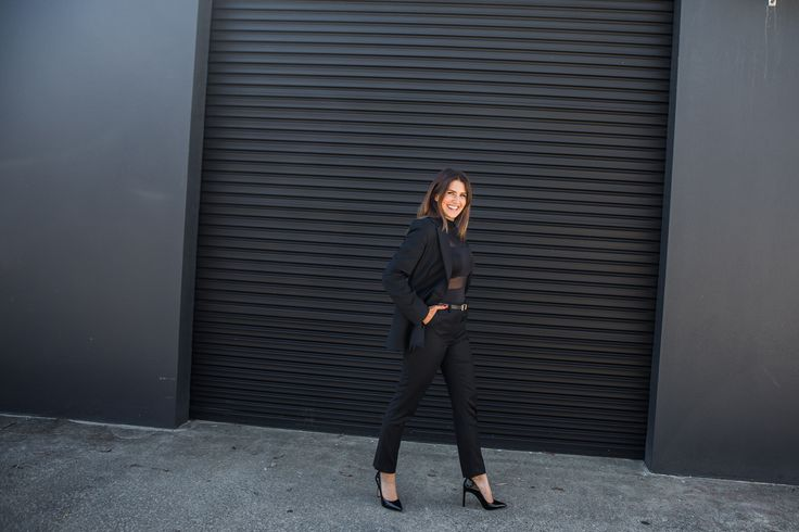 Smart casual women's fashion. How to style a tailored black suit for any occasion.