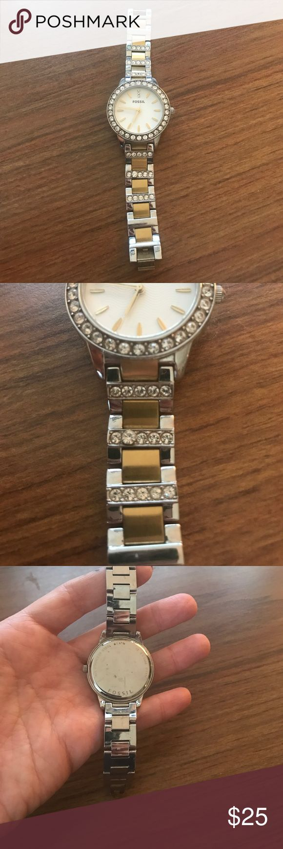Fossil watch women's Works perfect but does need new watch battery. Also one stone on band appears bigger than the others, slightly( in 2nd pic) fair condition. Gold and silver Fossil Accessories Watches