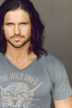 "John Hennigan. WWE/OVW names: John Morrison(current) /Nitro/Johnny Nitro/Johnny Blaze/Johnny Spade/Part of the tag team known as ""MNM""/Also part of tag team with The Miz/Tag partner of R-Truth/Also acts, does comedy Improv/stand up, WWFX Heavyweight Championship (1 time, current)Is in a long term real life relationship with Melina Perez"