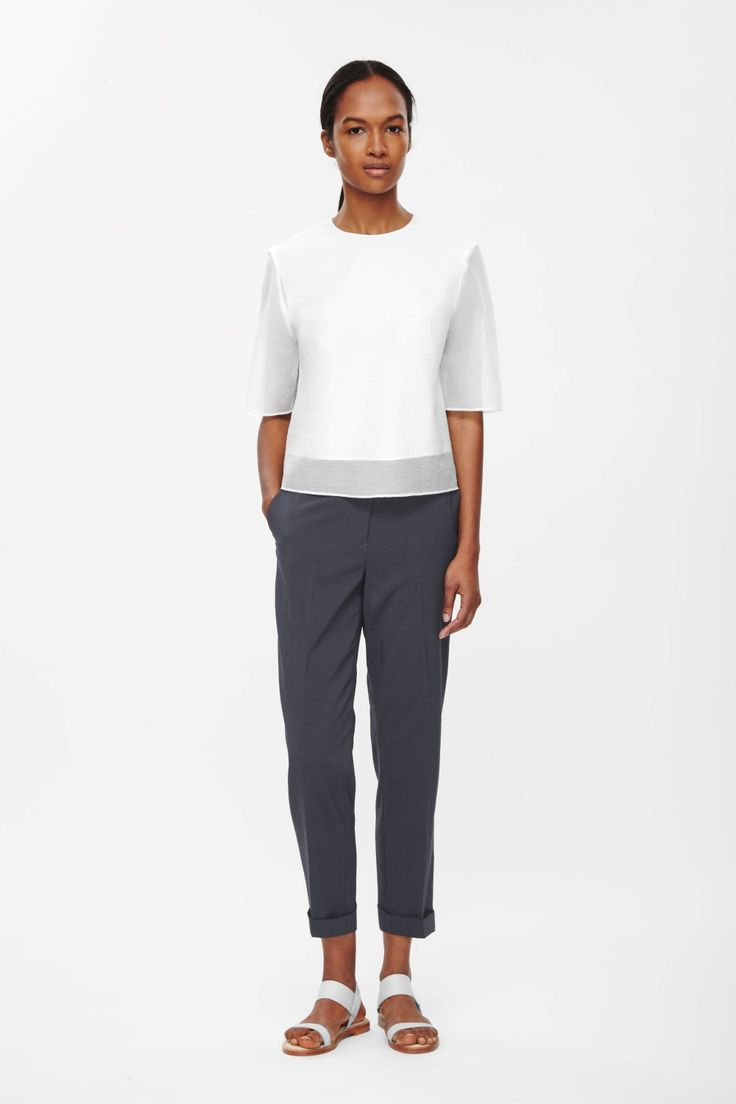 A straight-leg style with neat press folds along the front these tailored trousers are made from lightweight fabric with a textured feel. Designed to sit just below the waist, they have front and back pockets, cuffed hems and a classic zip fly fastening.