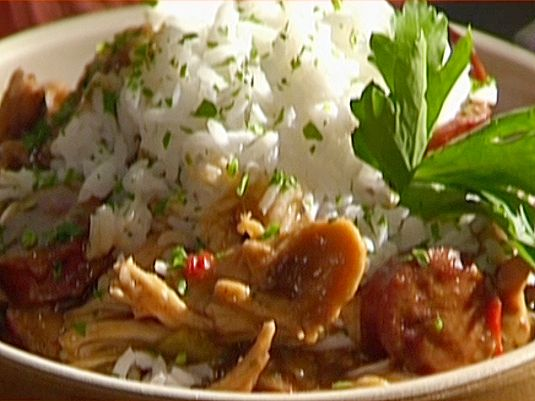 Food Network invites you to try this Chicken and Smoked Sausage Gumbo with White Rice recipe from Emeril Lagasse.
