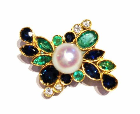 Central Pearl with Emeralds and Sapphires  This Brooch is realized with: Emeralds, Blue Sapphires, Diamonds brilliant cut and Pearl.  Emeralds 0,85 kt.  Blue Sapphires 0,65 kt.  Diamonds brilliant cut  0,08 kt.  F color  VVS 2  Japanese Pearl 7 mm.  Yellow Gold 18 kt.  Total Weight  5,70 g.  2350$  Available only on Www.bangslove.com
