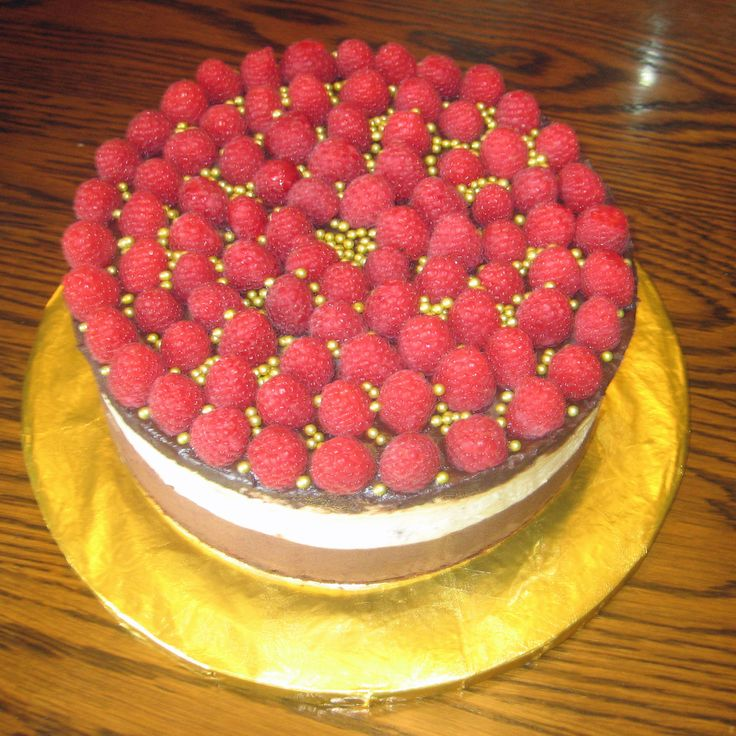 "Chocolate Raspberry Mousse Cake, 9"" round. For original recipe see: sugarhero.com.  A delicious dessert cake. 5 layers: chocolate sponge; then chocolate, raspberry, & vanilla mousse layers, topped with a chocolate ganache and fresh raspberries.  Will serve 20/30 easily. 2015"