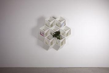 Wall hung honeycomb shaped shelf pockets. Imeuble by By Corporation   Designer: Bjørn Jørund Blikstad