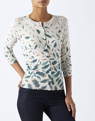 Z2018  A touch of metallic foil shimmers on our Whitney feather-print cardigan. Crafted in a fine knit, it features three-quarter sleeves, and elegant round necklin...