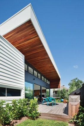 The roof's spotted gum contrasts with an unstained ironbark deck. Bower architecture