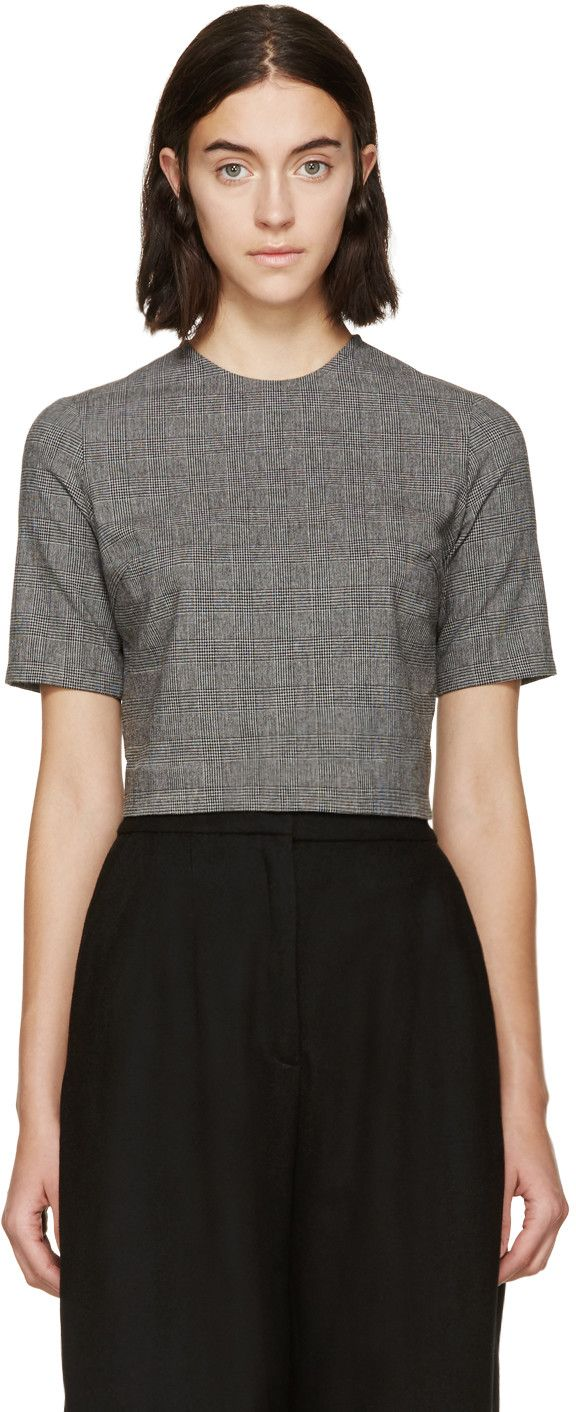 Cropped boxy top in tones of grey. Prince of Wales check throughout. Crewneck collar. Zip closure at back. Tonal stitching.