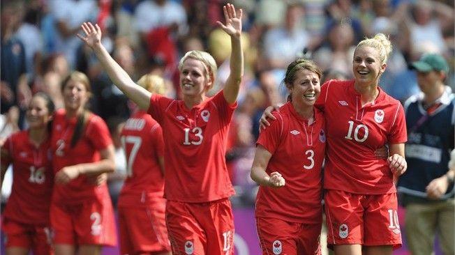 Sophie Schmidt, Chelsea Stewart and Lauren Sesselmann of Canada celebrate