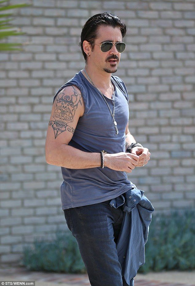 The way they were: Colin's tribal tattoo was in full view when he leftJoel Silver's Memor...