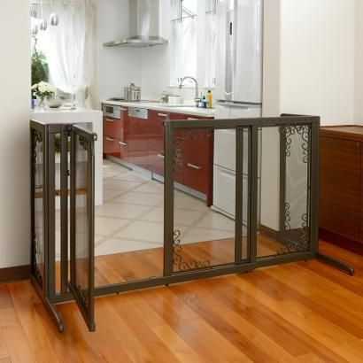 """Designer gate fits openings from 52.2"""" to 69.1"""" wide! Specially designed walk-thru door opens in both directions, locks automatically and remains open at 90˚ to allow you to move freely from one area to another. Includes Side Panels to prevent pet's from """"sneeking"""" thru on the sides."""