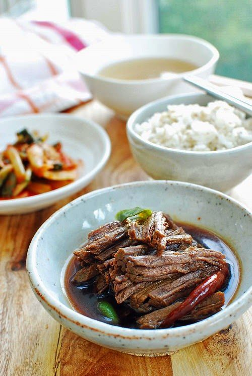 Jangjorim (장조림) is a soy-braised beef dish. It's a slightly sweet, salty side dish that's meant to be eaten in small amounts. So, a little bit of meat goes a long way. Back in the day, when beef was scarce, jangjorim was an economical way to put some beef on the table for the whole family. …