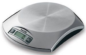 """Salter Digital Scale - Stainless Steel by Salter. $60.00. This electronic kitchen scale has a high-precision strain-gauge weight sensing system, an easy-.... Dimensions: 7¾""""L × 6¼""""W × 1½""""H. Sold individually. Colour/Pattern: Stainless steel. Capacity: 5 pounds/2 kilograms with 0.1 ounce/1 gram precision. This electronic kitchen scale has a high-precision strain-gauge weight sensing system, an easy-to-read digital display, Imperial/metric conversion switch..."""