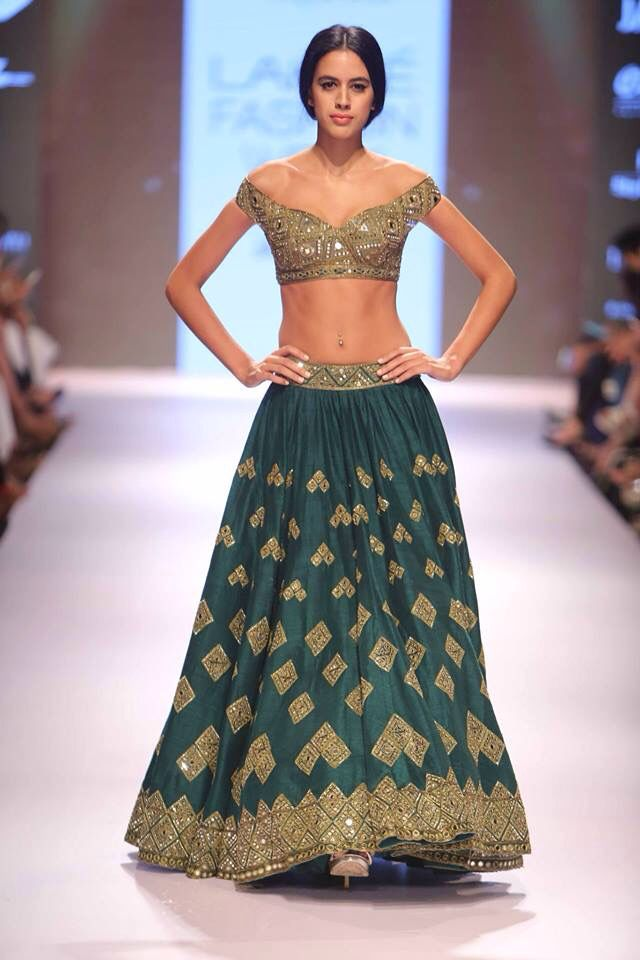 Green lengha with mirror work