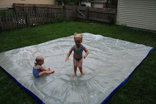 """""""redneck waterbed"""" made out a plastic painters tarp and duct tape. Can also add water and dish soap on top to make it into a slip and slide!"""