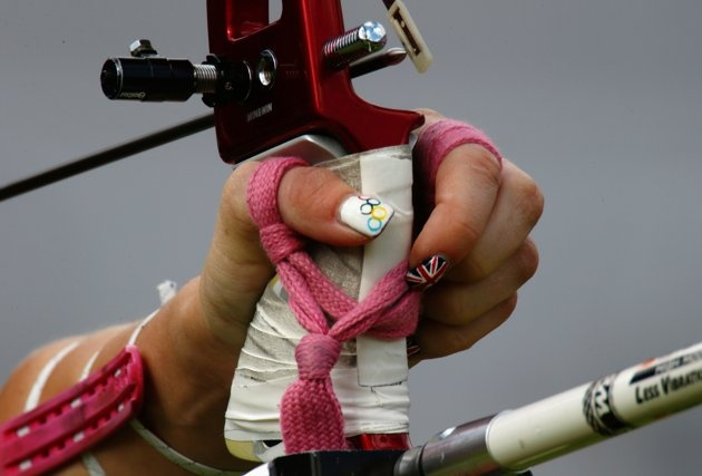 Amy Oliver–Great Britain–ArcheryJ  A detail view of the hand and nail varnish of Amy Oliver of Great Britain in action during the Women's Team Archery Eliminations match between Great Britain and Russia on Day 2 of the London 2012 Olympic Games at Lord's Cricket Ground on July 29, 2012 in London, England.