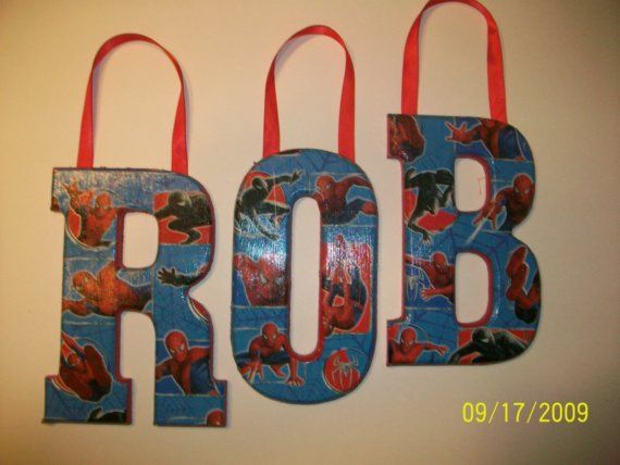Okay, so did she just use Spiderman wrapping paper and shellac the crap out of them? Because that means I can TOTALLY REFINISH BB'S LETTERS IN HIS ROOM AND NOT BUY NEW ONES! OMG! GENIUS!
