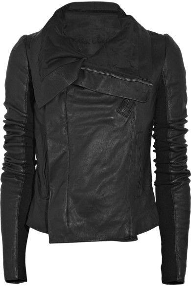 Black leather biker jacket with oversized lapels. Rick Owens jacket has concealed asymmetric silver-tone zip-fastening through front, zip-fastening welt pockets, long sleeves with ribbed wool-inserts, button-fastening pockets at interior and is fully lined. 90% leather, 10% wool; lining: 45% cotton, 40% rayon, 15% silk. Dry clean.