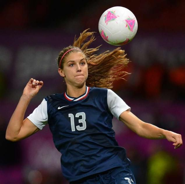Alex Morgan USA womens soccer team love her!  She's wearing my all time favorite # and kinda looks like an older version of me  <3