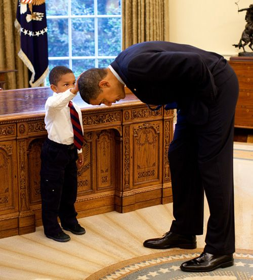this will always make me smile- this little guy wanted to see if President Obama's haircut felt like his own :)