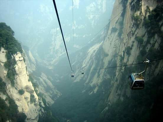 The most breathtaking cable car ride in the world; Mt. Huashan, China (WARNING: don't ride if you're afraid of heights)