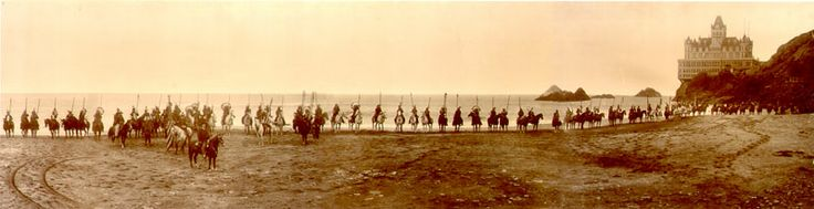 Buffalo Bill and his Wild West show crew line up on Ocean Beach, Sept. 1902. Photo from the Cliff House Project