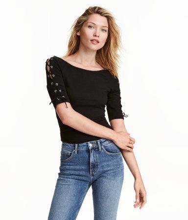 Black. Fitted, off-the-shoulder top in cotton jersey with lacing on the short sleeves.