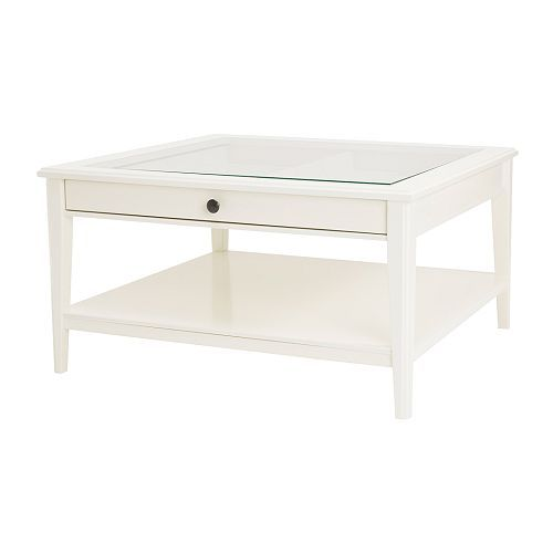 LIATORP Coffee Table from IKEA.  I love it because the drawer below the glass tabletop pulls out and is divided into four separate sections.  Great for extra storage or a fun way to display favorite family photos.  Easy to change from month to month, week to week, or even day to day.  Own it & love it!