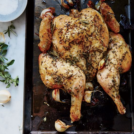 For his herb-roasted spatchcock chicken recipe, Tyler Florence keeps seasonings minimal. Herbs, olive oil and garlic make the chicken aromatic and flavorful. Get the recipe at Food & Wine.