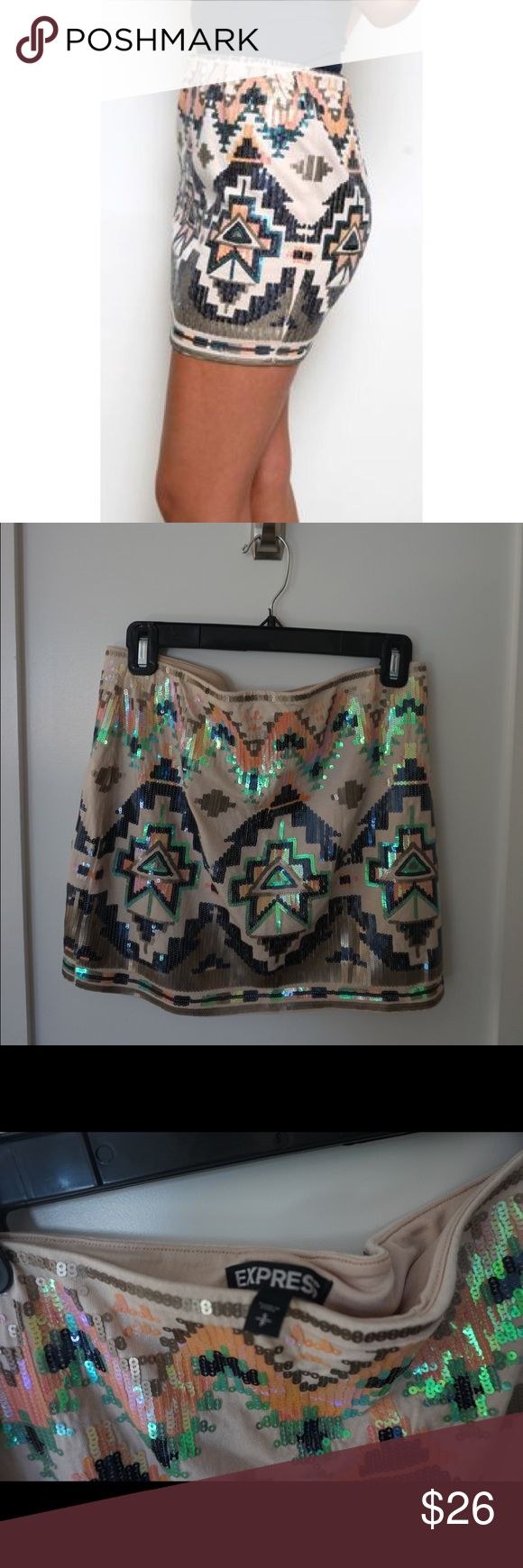 Express Aztec Sequin Skirt Super fun and cute Aztec styled skirt! Sparkles beautifully. Perfect for the club, sorority socials, and even family events! All the sequins are in place. Clean with no stretching of fabric or stains. Worn once. In great condition! Willing to price negotiate ✔️. No trades 🙅🏼. Express Skirts Mini