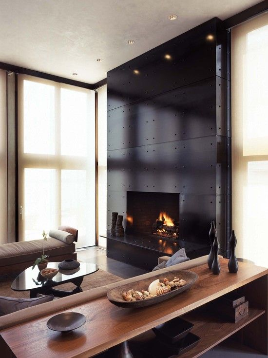 interesting industrial look for a fireplace modern